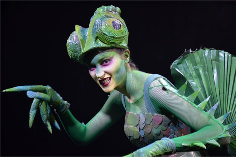 Georgia performing in her chameleon inspired costume