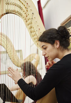 Harp student Ada Ragimov performing at the launch